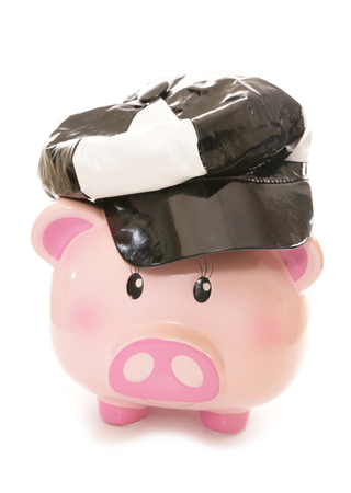 60s: piggy bank wearing 60s pvc cap cutout Stock Photo