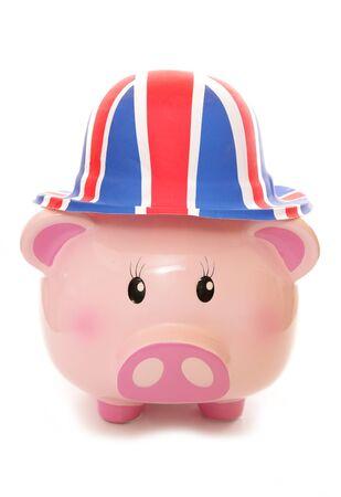 cutout: piggy bank wearing union jack hat cutout Stock Photo