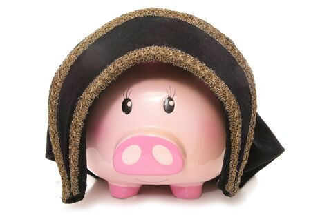 tudor: piggy bank wearing a tudor hat cutout