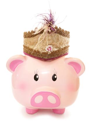 cutout: piggy bank wearing indian prince hat cutout