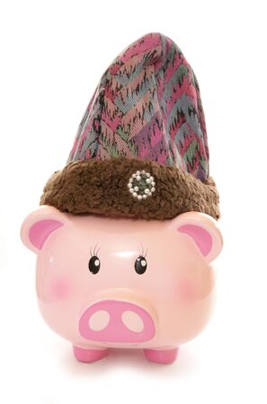 out dated: piggy bank wearing purple wooly hat cutout