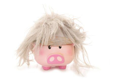 piggybank: piggybank wearing a beetlejuice wig cutout Stock Photo