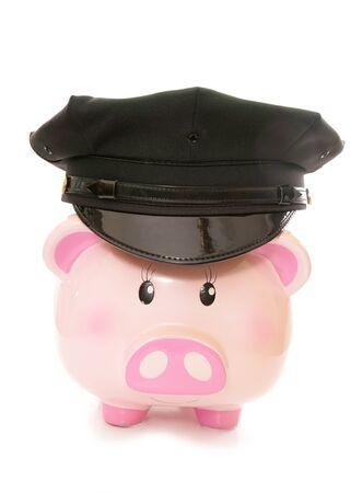 cutout: Piggy bank wearing american police cap cutout Stock Photo