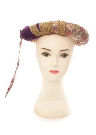 headress: mannequin wearing a sultan headress cutout