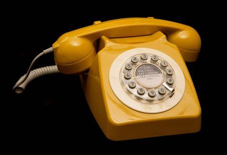 cutout: mustard retro style telephone cutout Stock Photo
