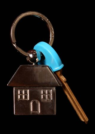 first time buyer: house keys on a black background