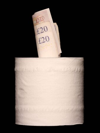 toilet roll: Money inside a toilet roll on black background