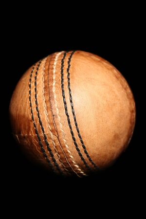 unmarked: vintage style cricket ball on black background