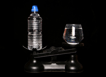 bottled water: bottled water better than tap water on scales Stock Photo