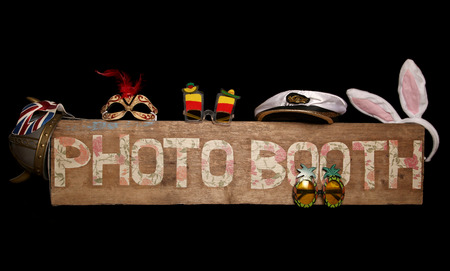 photo: Vintage looking photo booth sign on black background