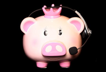 christmas savings: piggy bank wearing headset cutout