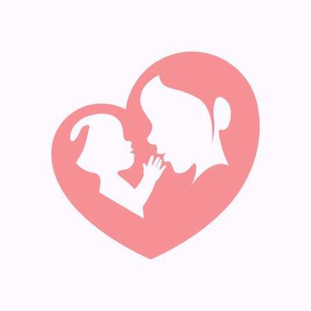 Mother holding a baby with her arm in heart shaped silhouette
