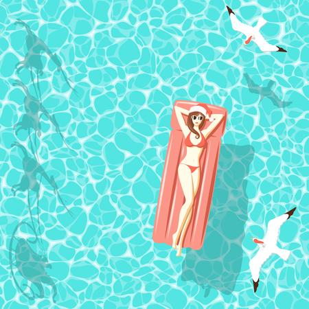 赤いビキニでサンタ帽子トナカイのサンタさんのそりの影を透明な青緑色の海に浮かぶ、上面からカモメが飛ぶ赤い空気マットレスの上リラックス