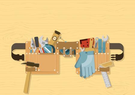 Outils dans la ceinture à outils avec sangle à boucle à dégagement latéral sur fond de bois, pour la construction, la réparation et le concept de bricolage