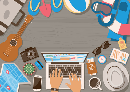 Hands of man planning trip on laptop with summer vacation elements on wooden table from top view in flat style