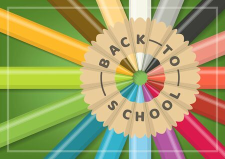 Back to school concept with realistic multicolor wooden color pencils in circular alignment on green background from close up top view