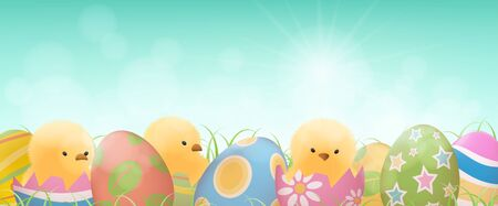 Colorful easter eggs and yellow chicks in cracked eggs with grass on clear blue sky background