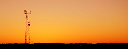 wireless tower: A cell phone tower silhouette in the sunset Stock Photo