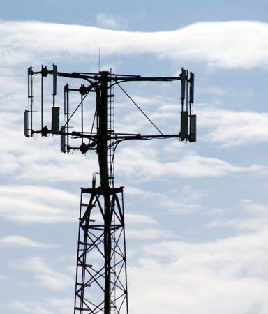 inform information: The top of a cell phone tower against a blue sky.
