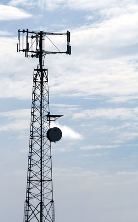 inform information: A cell phone tower set against a blue sky. Stock Photo