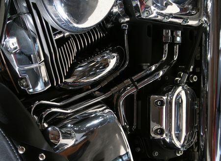 dinamismo: Il cromo motore di una moto.  Archivio Fotografico