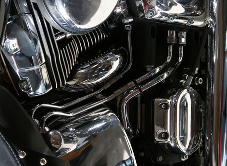 The chrome engine of a motorcycle. photo