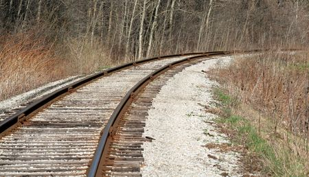 stay on course: A bend in a railroad track.