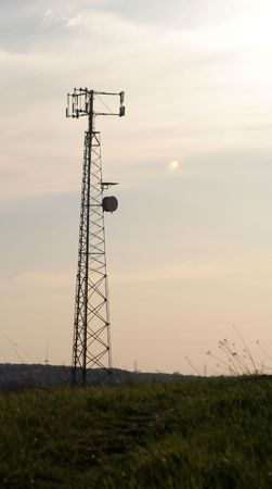 inform information: A cell phone tower with a grass base. Stock Photo