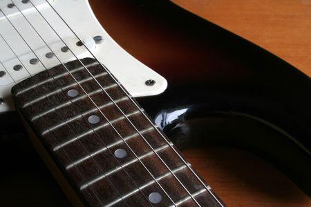 A close up of a guitar neck.