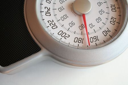 A closeup of a weight scale. 스톡 콘텐츠