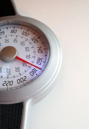 eat right: A closeup of a weight scale. Stock Photo