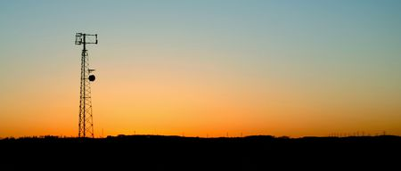disseminate: A cell phone tower silhouette in the sunset Stock Photo