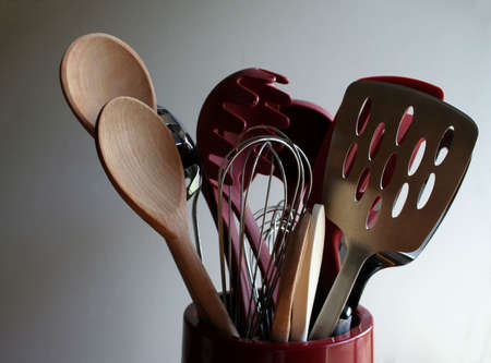 poach: A bucket of cooking utensils. Stock Photo