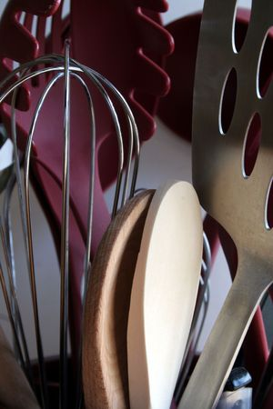 A bucket of cooking utensils. photo