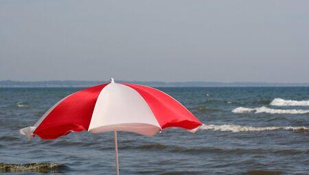 long weekend: A beach umbrella set against the sea.