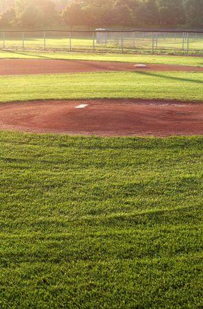 A baseball field cast in early morning light.