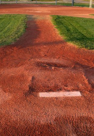 backstop: A view from directly behind a pitchers mound.