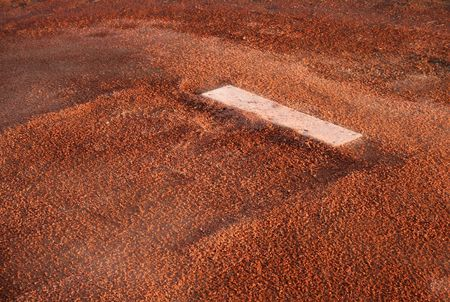 A closeup of the rubber on the pitchers mound. Banco de Imagens - 529399