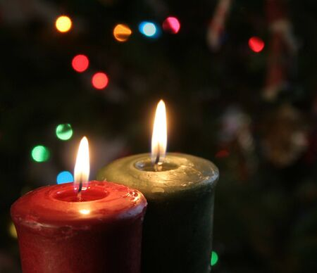 Christmas candles set against a tree. Stock Photo - 557106