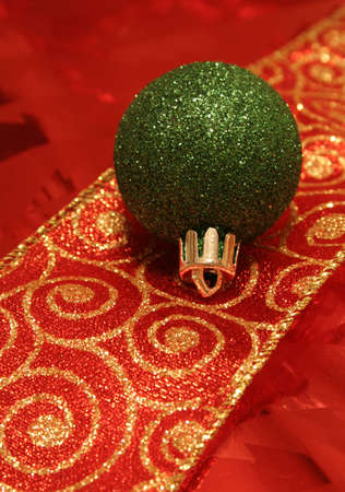 A sparkling green christmas ball ornament resting on a ribbon. Stock Photo - 585847