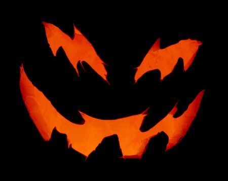 unearthly: A close up of a pumpkin carved with for halloween. Stock Photo