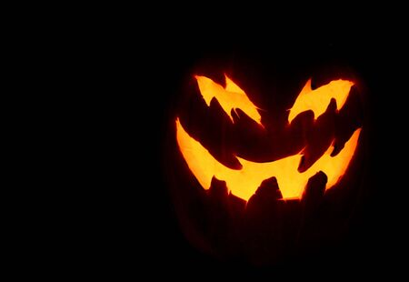 A close up of a pumpkin carved with for halloween. Banque d'images