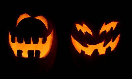 jackolantern: Two carved pumpkins glow on Halloween night.