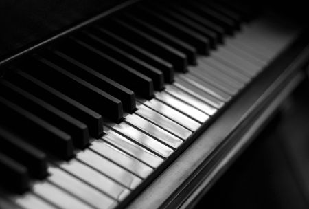 A closeup of the keys of a piano, shot with shallow depth of field.