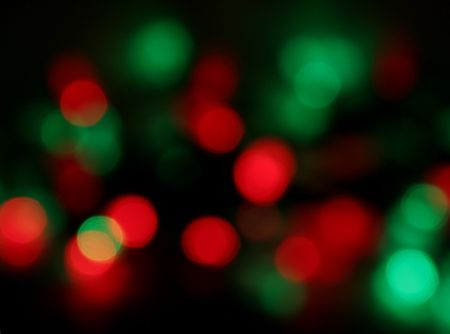 Red and green Christmas lights, blurred to create a holiday background.