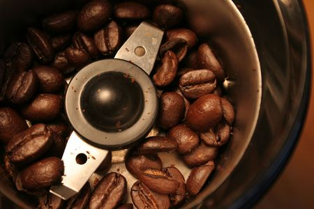 A birds eye view of coffee beans ready to be grinded. Stock Photo