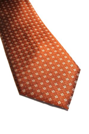A closeup of an isolated orange neck tie. photo