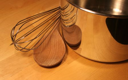 sizzle: Cooking Tools sitting on a wooden table.