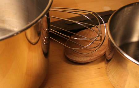 Various cooking tools sitting on a wooden table. photo