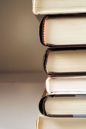 sideview: A stack of books shot on a sideview. Stock Photo